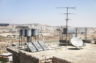 Water tank in Bethlehem in front of a settlement.